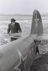 Bronisław Miodowski beside an aircraft of the USSR Military Air Force